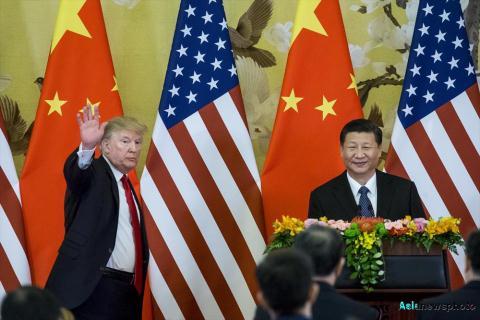 tong thong my donald trump (trai) va chu tich trung quoc tap can binh tai mot hop bao chung o bac kinh nam 2017. anh: china daily