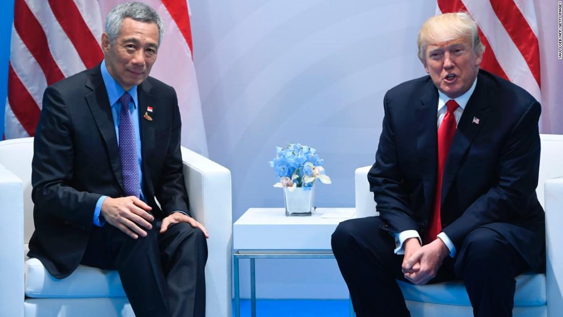 tong thong my donald trump (phai) va thu tuong singapore gap nhau tai hoi nghi thuong dinh g20 duc ngay 8/7