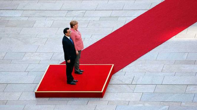 Bà Merkel gặp khó giữa Mỹ và Trung Quốc