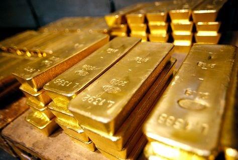 Giá vàng giảm sau một phiên dao động mạnh xuống gần mức thấp nhất 5,5 năm qua